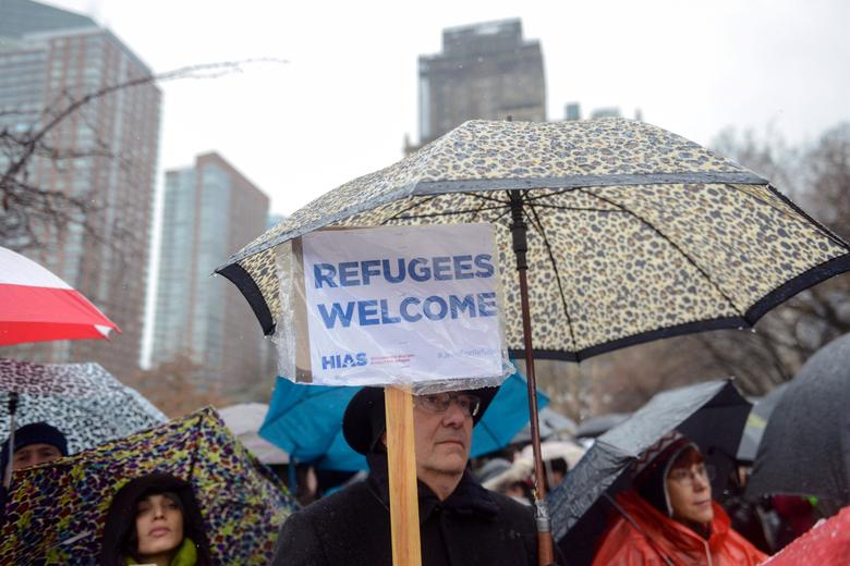 People participate in a protest against U.S. President Donald Trump's immigration policy at the Jewish Rally for Refugees in New York City, U.S. February 12, 2017. REUTERS/Stephanie Keith