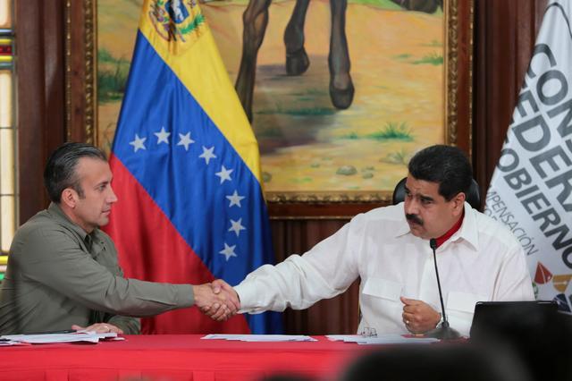 Venezuela's President Nicolas Maduro (R) and Venezuela's Vice President Tareck El Aissami, shake hands during a meeting with governors in Caracas, Venezuela February 14, 2017. Miraflores Palace/Handout via REUTERS