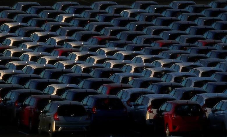 Newly manufactured cars await export at port in Yokohama, Japan, January 16, 2017. Picture taken January 16, 2017.  REUTERS/Toru Hanai