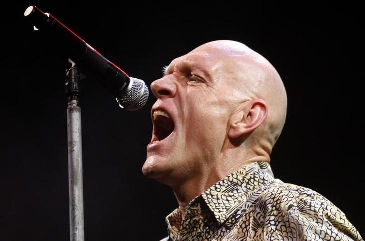 File photo - Australia's Environment Minister Peter Garrett performs with his band Midnight Oil during the Sound Relief bushfire benefit concert in Melbourne March 14, 2009.  REUTERS/Mick Tsikas