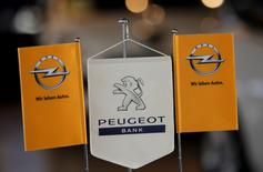 FILE PHOTO: The logo of Opel and the bank of French car maker Peugeot are seen at a Opel and Peugeot dealership in Leverkusen, Germany, October 22, 2012.    REUTERS/Wolfgang Rattay/File Photo