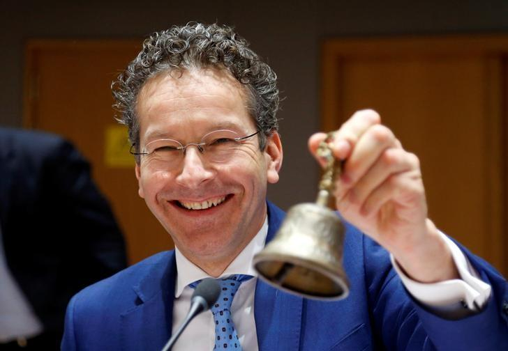 Dutch Finance Minister and Eurogroup President Jeroen Dijsselbloem rings the bell at the start of a eurozone finance ministers meeting in Brussels, Belgium February 20, 2017. REUTERS/Francois Lenoir