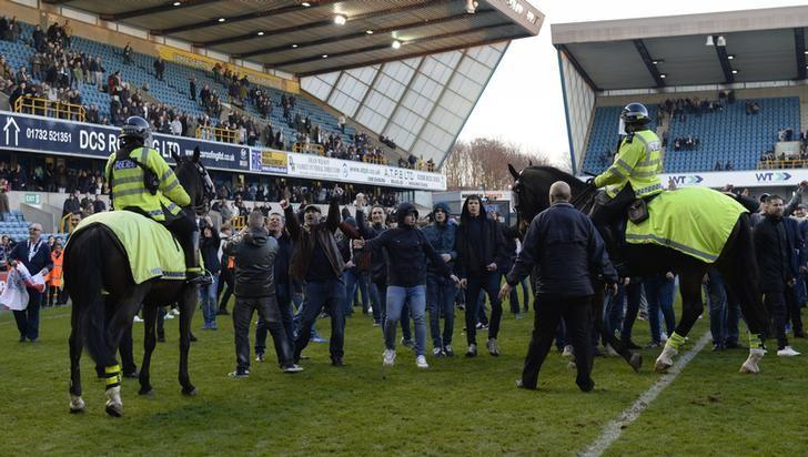 Britain Soccer Football - Millwall v Leicester City - FA Cup Fifth Round - The New Den - 18/2/17 Police, Stewards and Millwall fans on the pitch after the match  Action Images via Reuters / Tony O'Brien Livepic