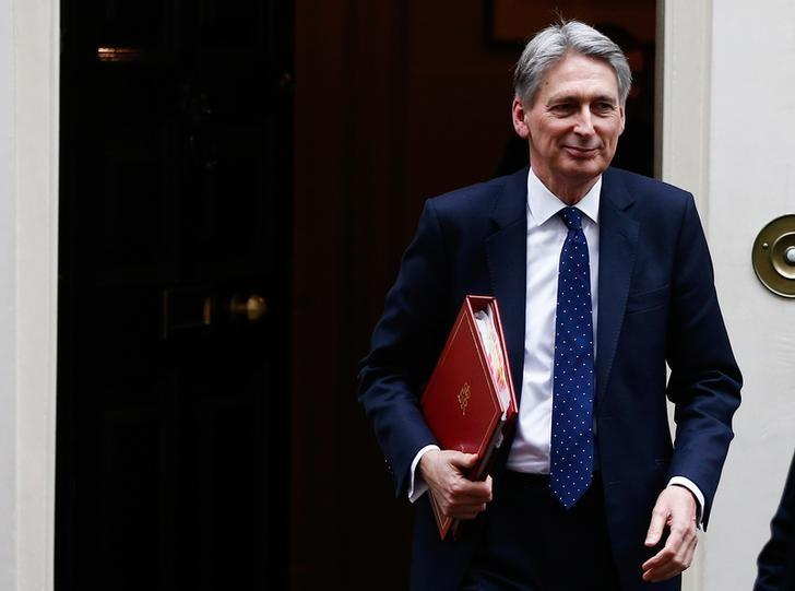 Britain's Chancellor of the Exchequer Philip Hammond leaves 11 Downing Street, London, January 31, 2017. REUTERS/Peter Nicholls/Files