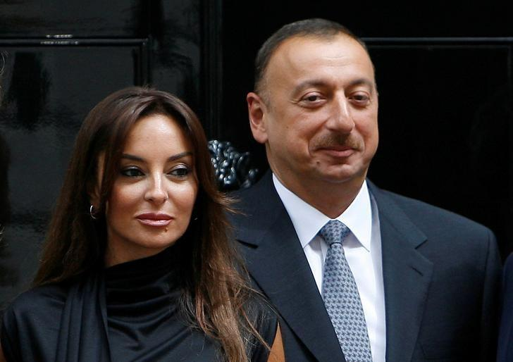 FILE PHOTO: Azerbaijan's President Ilham Aliyev (R) and his wife Mehriban pose for photographers after a meeting at 10 Downing Street in London, Britain July 13, 2009.    REUTERS/Luke MacGregor/File Photo
