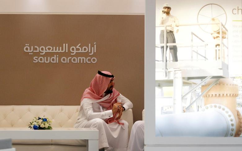 FILE PHOTO: A Saudi Aramco employee sits near its stand at Middle East Petrotech 2016 in Manama, Bahrain, September 27, 2016. REUTERS/Hamad I Mohammed/File Photo