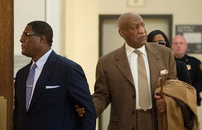 File Photo: Bill Cosby (R) re-enters Montgomery County Courthouse after a break during the second day of his pre-trial hearing in his sexual assault case in Norristown, Pennsylvania, December 14, 2016.  REUTERS/Chloe Elmer/Pool/Files