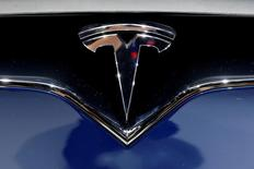 FILE PHOTO - A Tesla logo is seen on media day at the Paris auto show, in Paris, France, September 30, 2016. REUTERS/Benoit Tessier/File Photo