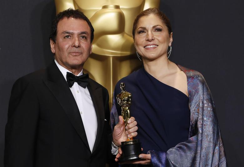 89th Academy Awards - Oscars Backstage - Hollywood, California, U.S. - 26/02/17 - Anousheh Ansari and Firouz Naderi pose with the Oscar they accepted on behalf of Asghar Farhadi, who won the Best Foreign Language Film for ''The Salesman''. REUTERS/Lucas Jackson