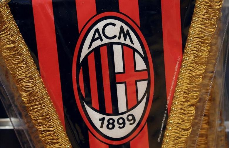 The AC Milan logo is pictured on a pennant in a soccer store in downtown Milan, Italy April 29, 2015. REUTERS/Stefano Rellandini/File Photo