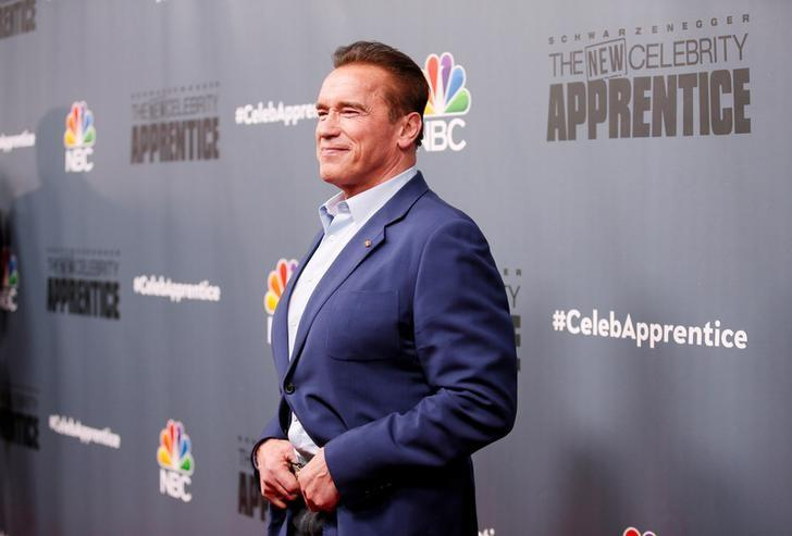 File Photo: Host Arnold Schwarzenegger poses after a panel for ''The New Celebrity Apprentice'' in Universal City, California, December 9, 2016. REUTERS/Danny Moloshok/File Photo