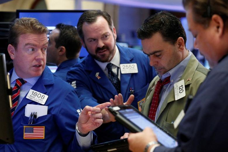 A trader works on the floor of the New York Stock Exchange (NYSE) in New York, U.S., March 1, 2017. REUTERS/Brendan McDermid