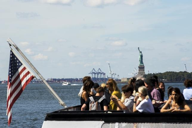 A boatload of tourists stand on a boat as it departs from Battery Park in New York August 27, 2015. REUTERS/Lucas Jackson