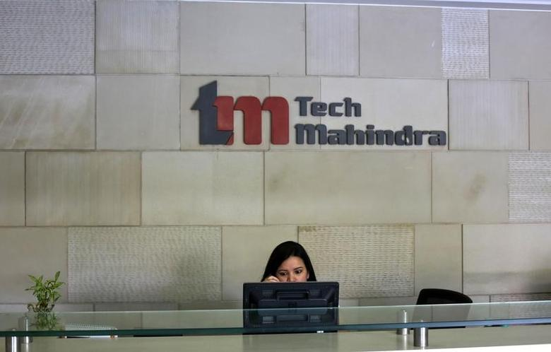 An employee sits at the front desk inside Tech Mahindra office building in Noida on the outskirts of New Delhi March 18, 2013. REUTERS/Adnan Abidi