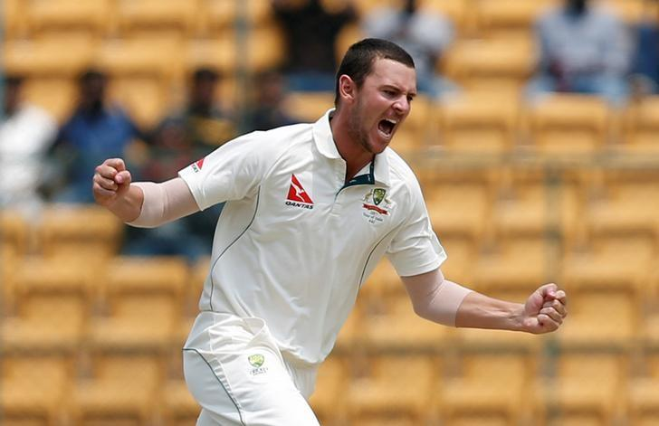 Cricket - India v Australia - Second Test cricket match - M Chinnaswamy Stadium, Bengaluru, India - 06/03/17 - Australia's Josh Hazlewood celebrates the wicket of India's Abhinav Mukund. REUTERS/Danish Siddiqui