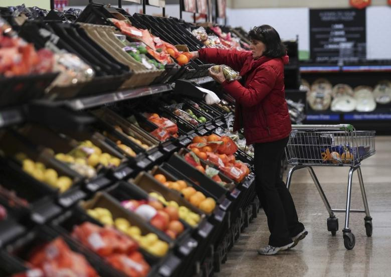A shopper selects fruit at the Asda superstore in High Wycombe, Britain, February 8, 2017.  REUTERS/Eddie Keogh