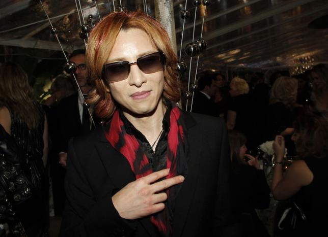 Japanese musician Yoshiki from rock band X Japan poses inside HBO after party following the 69th annual Golden Globe Awards in Beverly Hills, California January 15, 2012. REUTERS/Danny Moloshok