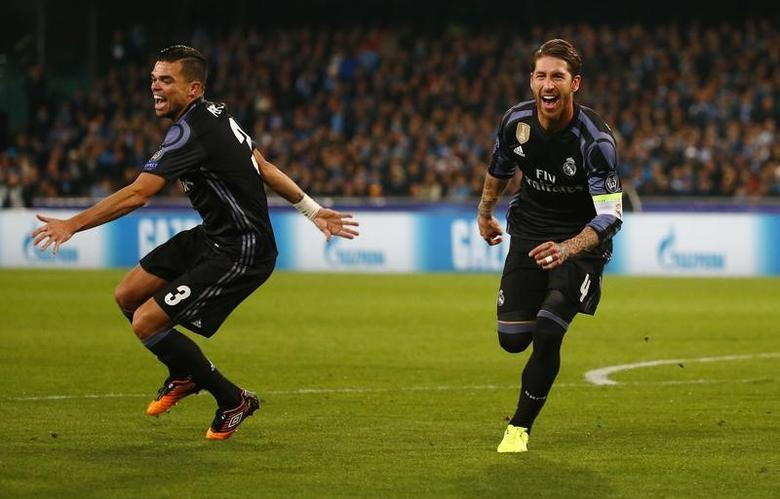 Football Soccer - Napoli v Real Madrid - UEFA Champions League Round of 16 Second Leg - Stadio San Paolo, Naples, Italy - 7/3/17 Real Madrid's Sergio Ramos celebrates scoring their second goal Reuters / Tony Gentile Livepic