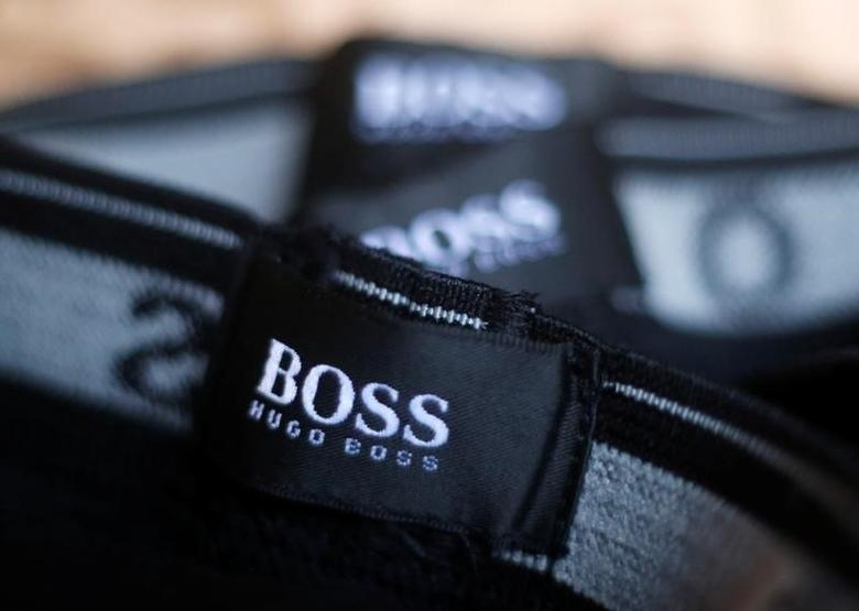 The logo of German fashion house Hugo Boss is seen on a clothing label at their outlet store in Mezingen near Stuttgart October 29, 2013.  REUTERS/Michael Dalder/File Photo