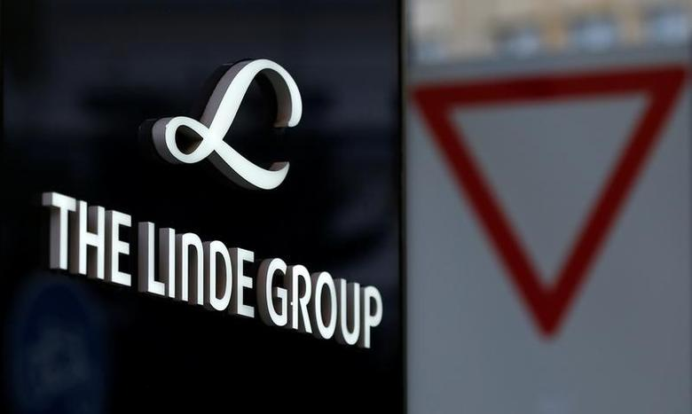 Linde Group logo is pictured close to a traffic sign near its headquarters in Munich, Germany August 15, 2016. REUTERS/Michaela Rehle