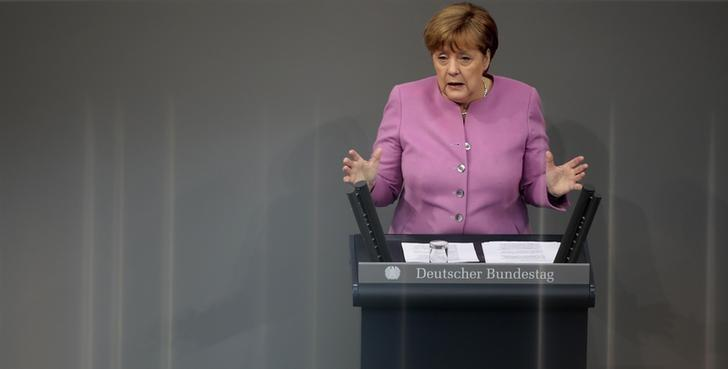 German Chancellor Angela Merkel addresses the German lower house of parliament Bundestag in Berlin, Germany, March 9, 2017. Lines in the background are light reflections.     REUTERS/Axel Schmidt