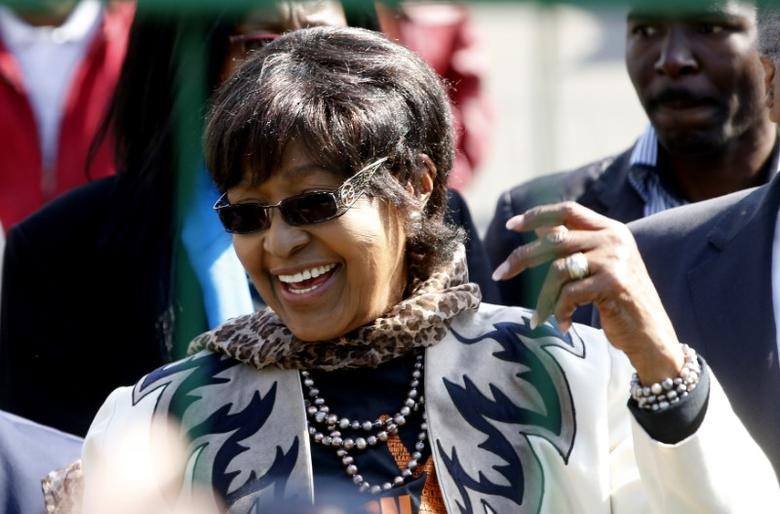 Winnie Madikizela-Mandela greets wellwishers gathered to wish to former President Nelson Mandela happy birthday outside the hospital where he is being treated in Pretoria, July 18, 2013.   REUTERS/Mike Hutchings