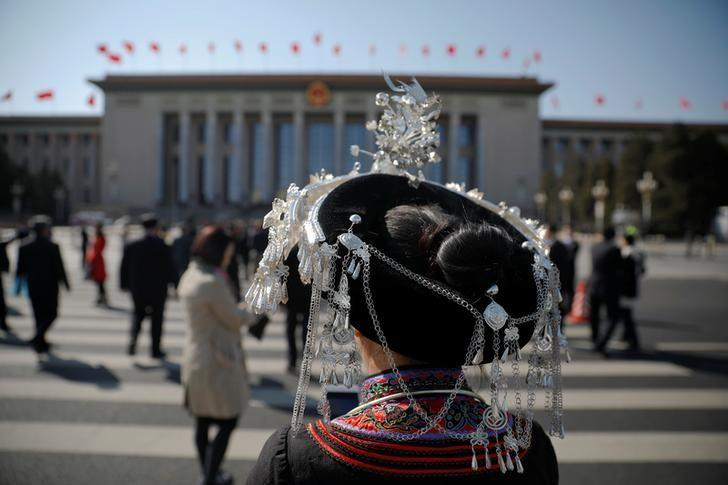 A delegate wearing a traditional costume arrives at the Great Hall of the People before the second plenary session of the National People's Congress (NPC) in Beijing, China March 8, 2017. REUTERS/Damir Sagolj
