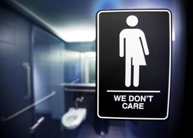 A sign protesting a recent North Carolina law restricting transgender bathroom access adorns the bathroom stalls at the 21C Museum Hotel in Durham, North Carolina May 3, 2016.  REUTERS/Jonathan Drake/File Photo