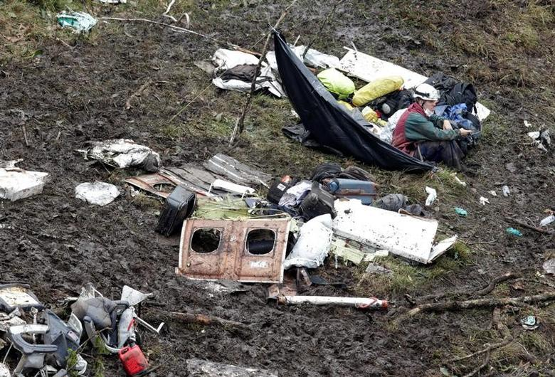 FILE PHOTO: A rescue worker sits near the wreckage of a plane that crashed into the Colombian jungle with Brazilian soccer team Chapecoense onboard near Medellin, Colombia, November 29, 2016  REUTERS/Jaime Saldarriaga