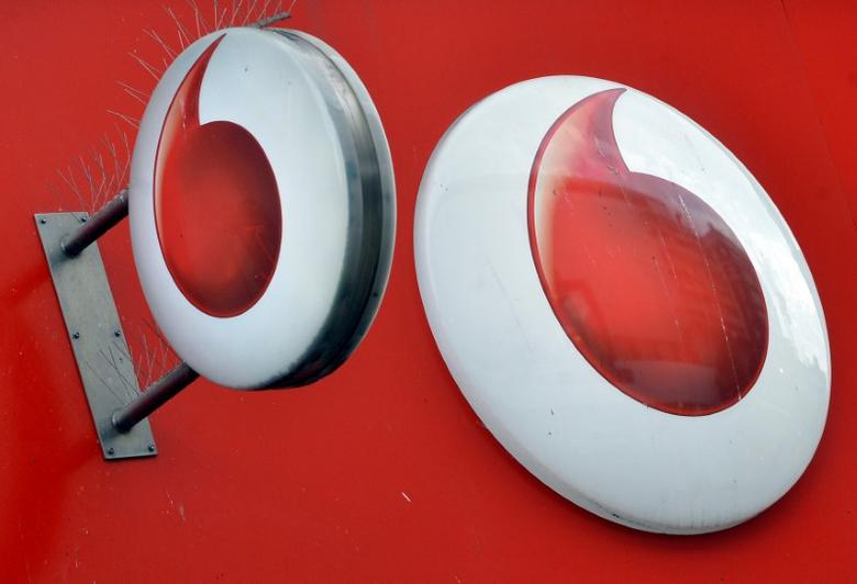 FILE PHOTO: Vodafone branding is seen outside a retail store in London, Britain November 12, 2013.    REUTERS/Toby Melville/File Photo
