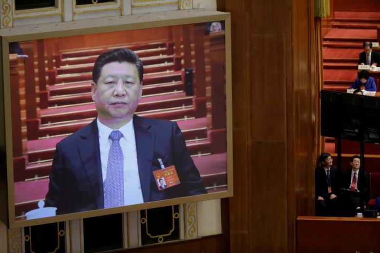 A screen shows China's President Xi Jinping during the second plenary session of the National People's Congress (NPC) at the Great Hall of the People in Beijing, China March 8, 2017. REUTERS/Jason Lee