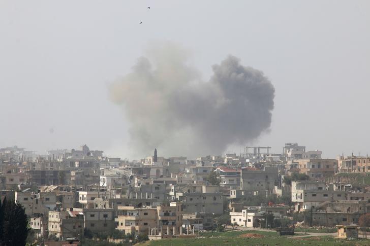 Smoke rises after strikes on rebel-held Deraa city, Syria March 10, 2017. REUTERS/Alaa Al-Faqir