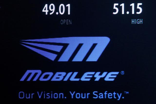 FILE PHOTO: A logo and stock price information for automotive industry supplier Mobileye NV is displayed on a screen where the stock is traded on the floor of the NYSE, August 23, 2016.  REUTERS/Brendan McDermid/File Photo