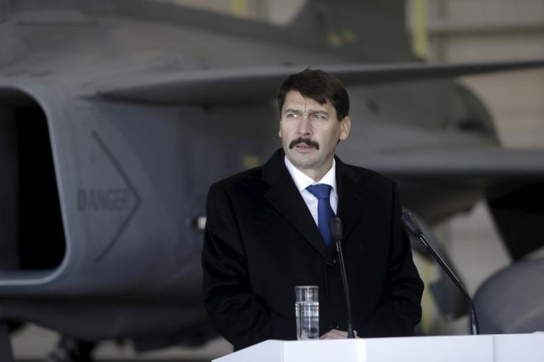 Hungarian President Janos Ader speaks to the media in front of a Hungarian Air Force Gripen JAS-39 fighter as he visits NATO's air policing mission over the Baltics in Siauliai Air Base, Lithuania, December 8, 2015. REUTERS/Ints Kalnins