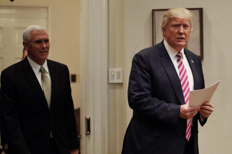 U.S. President Donald Trump and Vice President Mike Pence (L) attend a healthcare meeting with key House Committee Chairmen at the White House in Washington, U.S., March 10, 2017.  REUTERS/Carlos Barria