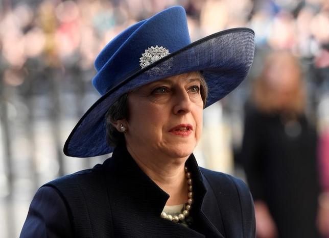 3月13日、英国のメイ首相報道官は、欧州連合(EU)離脱に向けた正式な手続き着手時期について、今月末までと強調した。写真はメイ首相、ロンドンで撮影(2017年 ロイター/Toby Melville)