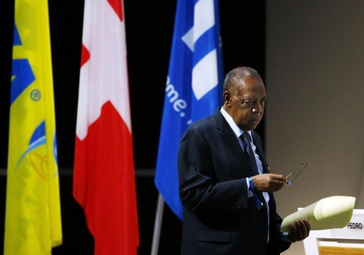 Issa Hayatou walks back to his seat after an address during the Extraordinary FIFA Congress in Zurich, Switzerland February 26, 2016. REUTERS/Ruben Sprich