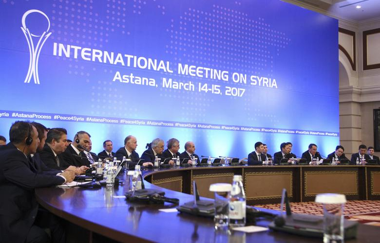 Participants of Syria peace talks attend a meeting in Astana, Kazakhstan March 15, 2017. REUTERS/Mukhtar Kholdorbekov