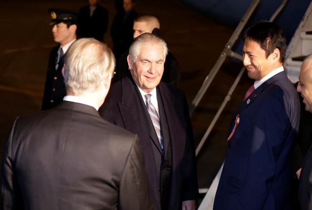 U.S. Secretary of State Rex Tillerson, second left, arrives during his first trip to Asia as Secretary, at Haneda International Airport in Tokyo, Wednesday, March 15, 2017. REUTERS/Eugene Hoshiko/Pool