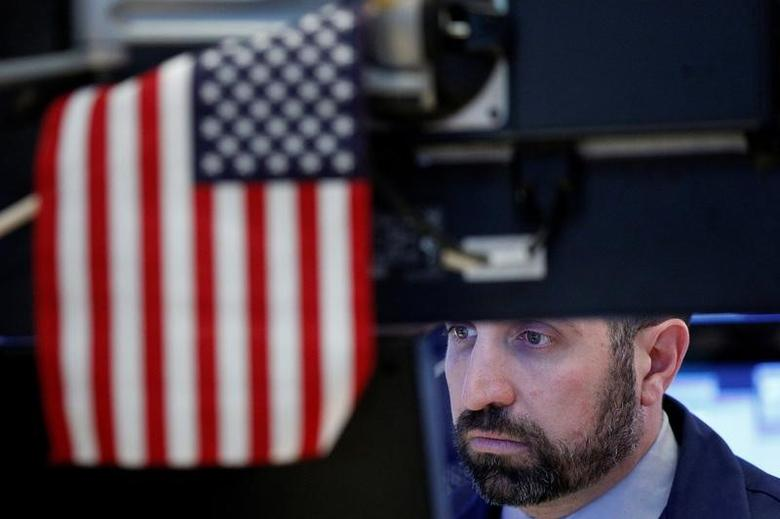 A specialist trader works at his post on the floor of the New York Stock Exchange (NYSE) in New York, U.S., March 8, 2017. REUTERS/Brendan McDermid