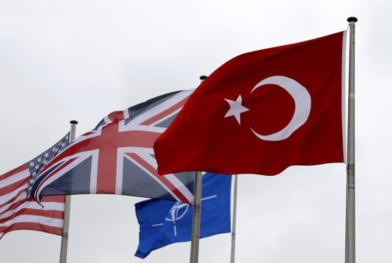 A Turkish flag (R) flies among others flags of NATO members during the North Atlantic Council (NAC) at the Alliance headquarters in Brussels, Belgium, July 28, 2015. REUTERS/Francois Lenoir/Files