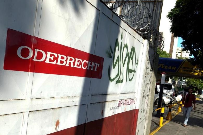 A man walks past the corporate logo of Odebrecht in a construction site in Caracas, Venezuela January 26, 2017. REUTERS/Carlos Garcia Rawlins