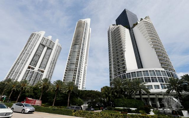 From left, the Trump Royale, The Trump Palace and the Trump International Beach Resort are shown in Sunny Isles Beach, Florida, U.S. March 13, 2017.   REUTERS/Joe Skipper