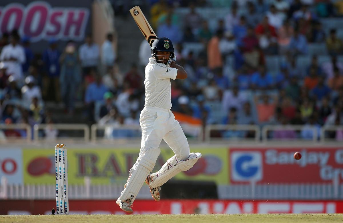 Patient Pujara helps India to narrow deficit with Australia