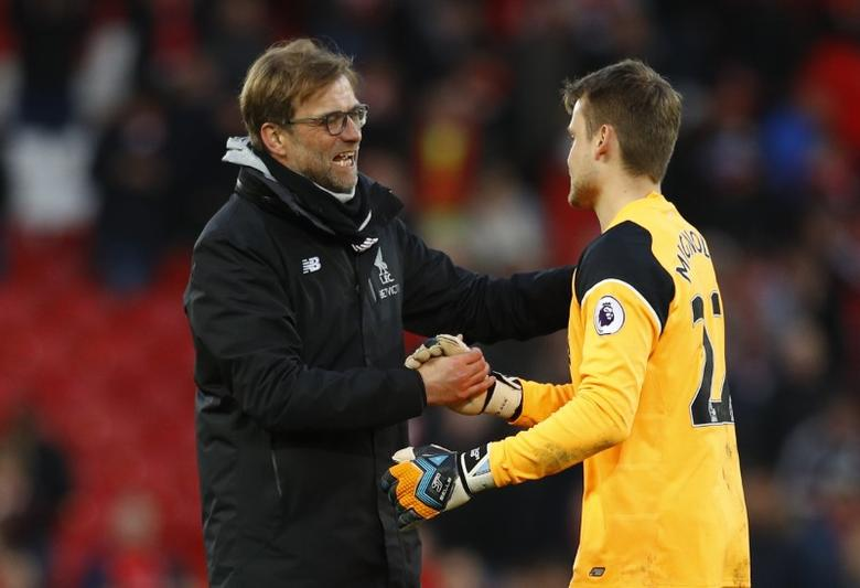 Liverpool v Burnley - Premier League - Anfield - 12/3/17 Liverpool manager Juergen Klopp and Simon Mignolet celebrate after the game  Reuters / Phil Noble Livepic