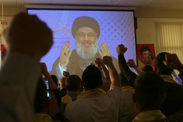 FILE PHOTO Lebanon's Hezbollah leader Sayyed Hassan Nasrallah addresses his supporters from a screen during a rally to commemorate Hezbollah Wounded Veterans Day in Beirut's southern suburbs, Lebanon, May 12, 2016. REUTERS/Aziz Taher/Files