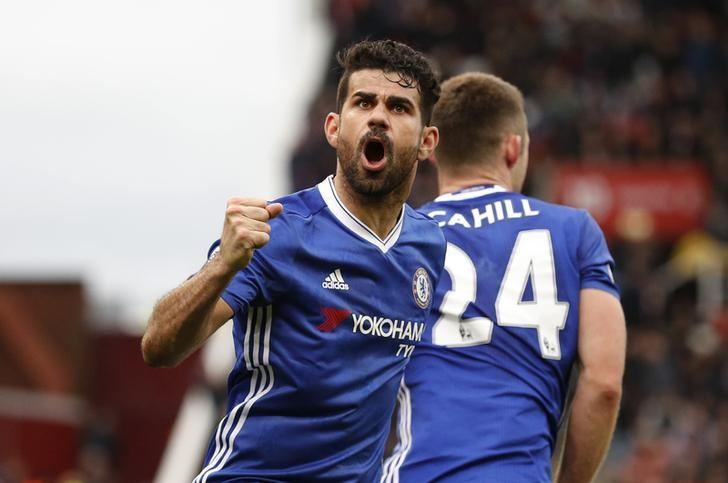 Britain Football Soccer - Stoke City v Chelsea - Premier League - bet365 Stadium - 18/3/17 Chelsea's Gary Cahill celebrates with Diego Costa scoring their second goal  Reuters / Phil Noble Livepic