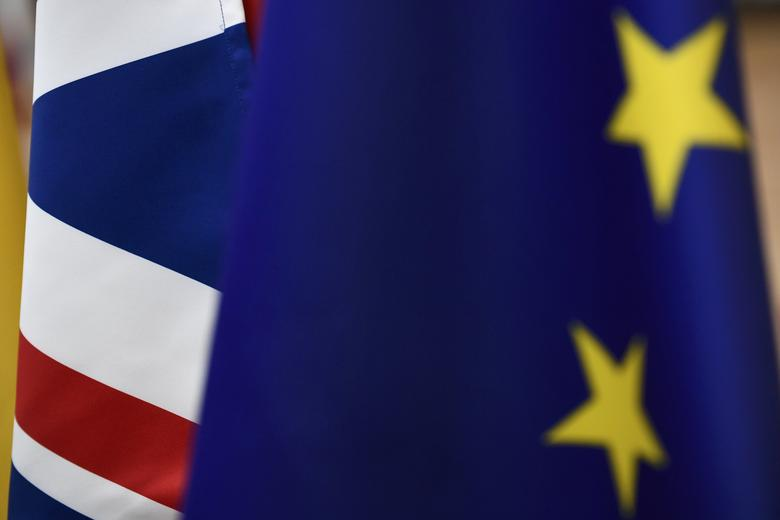 Britain's Union flag and the European flag on display ahead of the EU summit in Brussels, Belgium, March 9, 2017.    REUTERS/Dylan Martinez