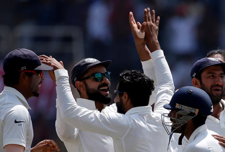 India v Australia - Third Test cricket match - Jharkhand State Cricket Association Stadium, Ranchi, India - 20/03/17 - India's captain Virat Kohli (C) celebrates the dismissal of his Australian counterpart Steven Smith with his teammates. REUTERS/Adnan Abidi