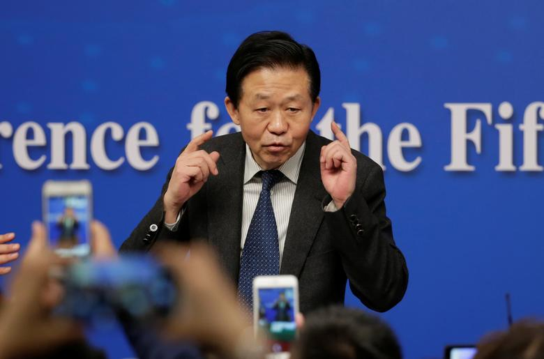 Chinese Finance Minister Xiao Jie speaks to the media after his news conference during the ongoing National People's Congress (NPC), China's parliament, in Beijing China March 7, 2017. REUTERS/Jason Lee
